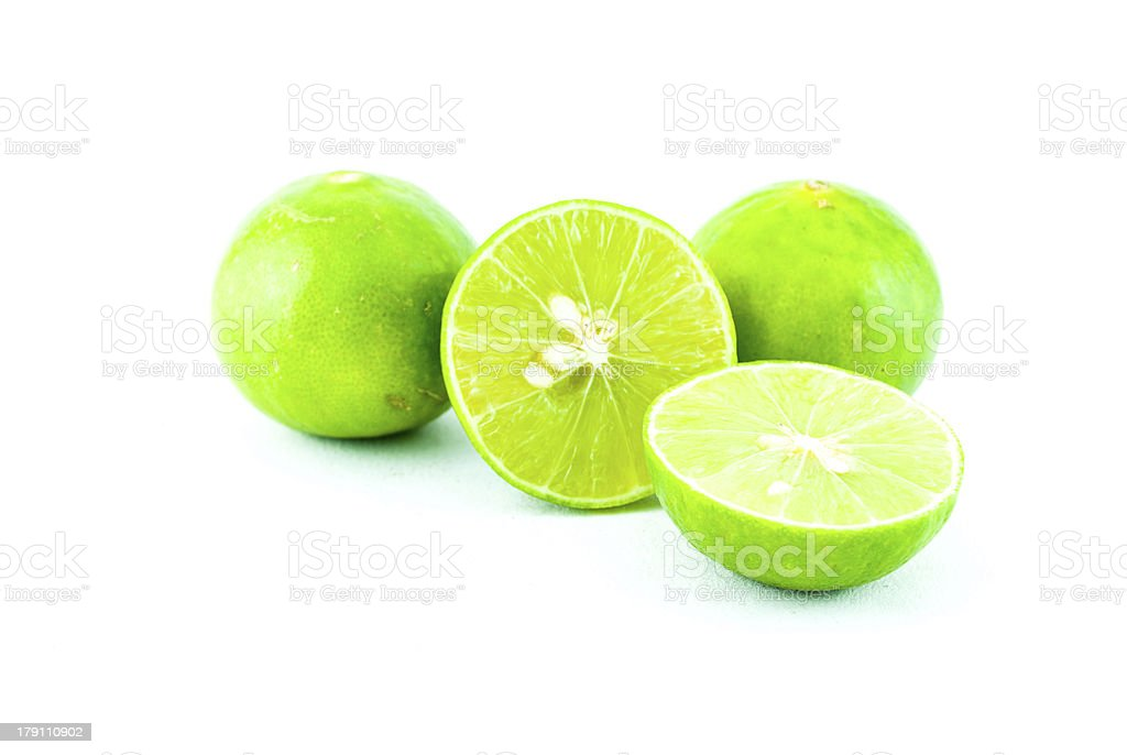 Green fresh lime and slice, Isolated royalty-free stock photo