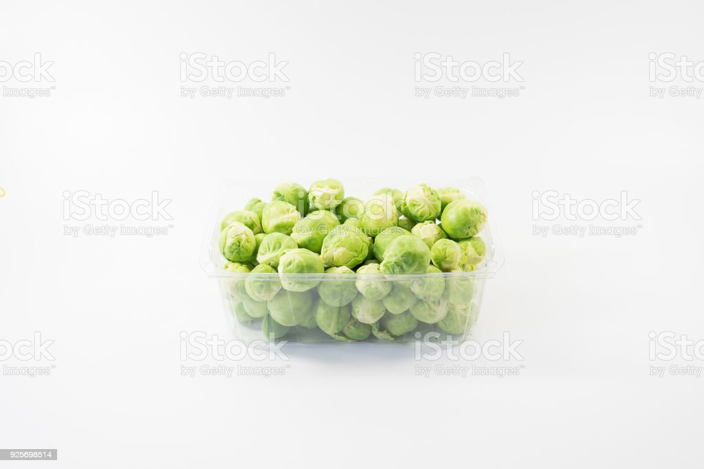 Green fresh raw brussel sprout cabbage from garden nature inside square trasparent box, stock photo