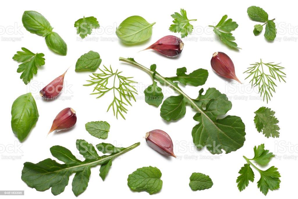 green fresh rucola leaves isolated on white background. Rocket salad or arugula. stock photo