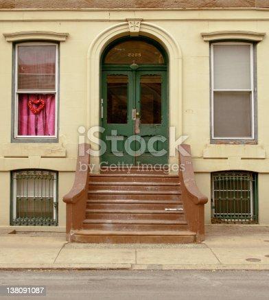 Green front door, stoop, and sidewalk.  Philadelphia, PA.