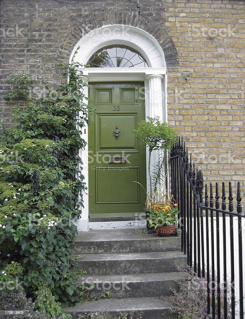 Green front door royalty-free stock photo