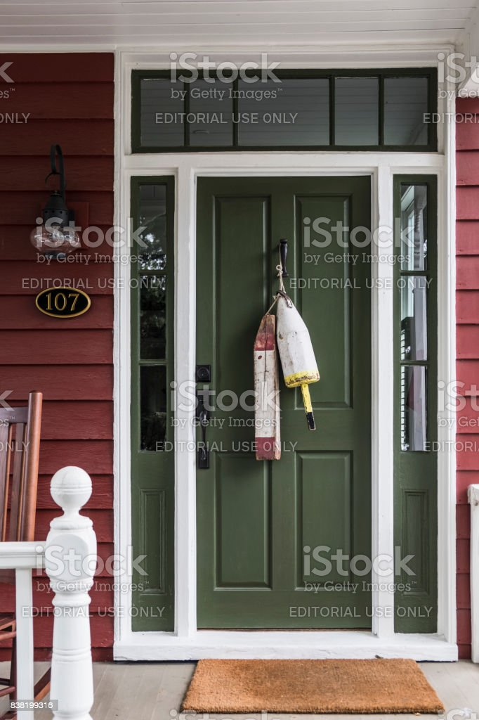 Green Front Door with Buoys in St. Michael's, Maryland. stock photo