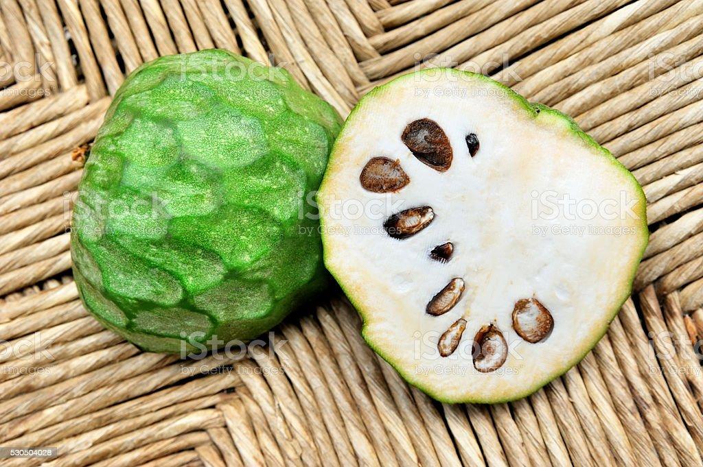 green fruit cherimoya stock photo