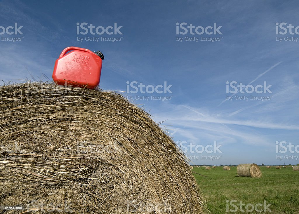Green Fuel, Gasoline on Hay Bale, Biofuel Concept stock photo