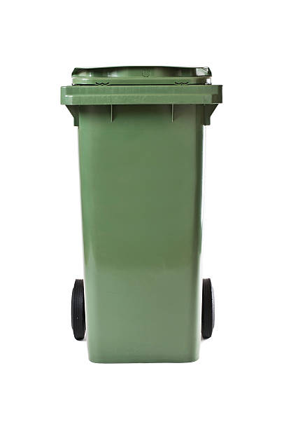 Green garbage bin isolated on white background stock photo