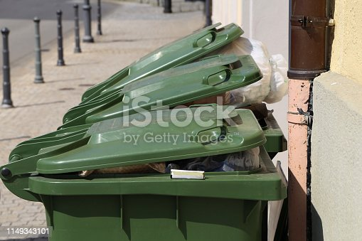 istock Green garbage cans are on the street 1149343101