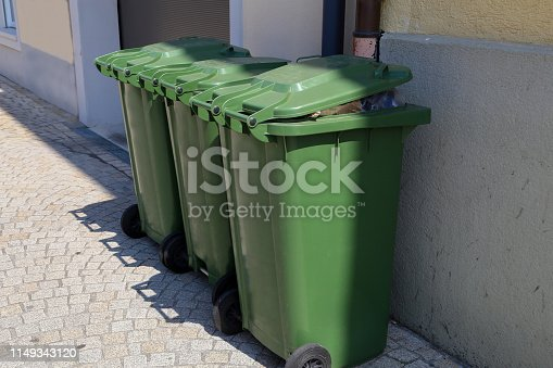 istock Green garbage cans are on the street 1149343120
