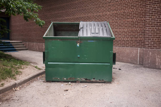 green garbage dumpster - garbage bin stock photos and pictures