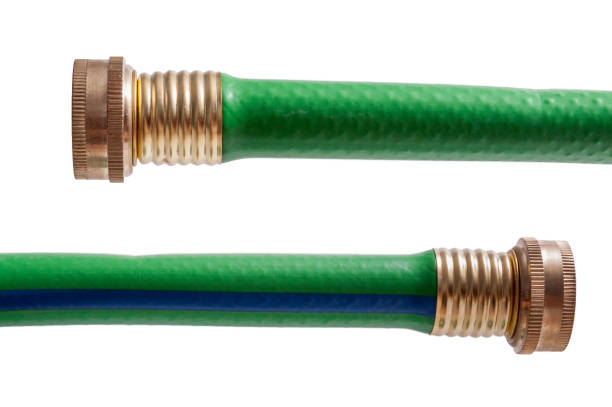 green garden hose isolated - garden hose stock pictures, royalty-free photos & images