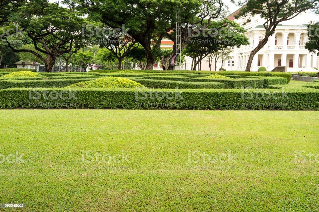 Green garden in Thai style castle stock photo