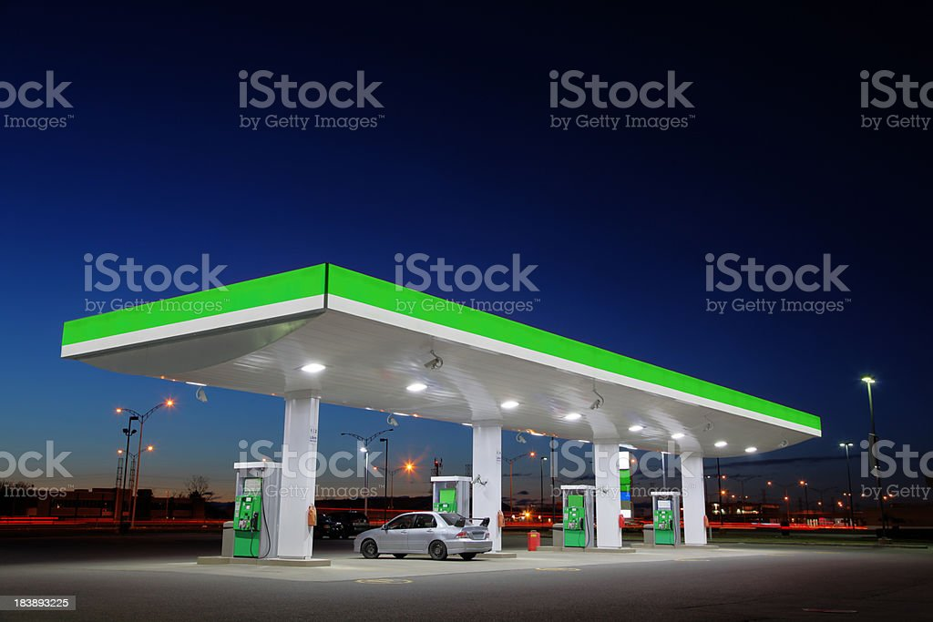 Green Gas Station Lights at Night stock photo