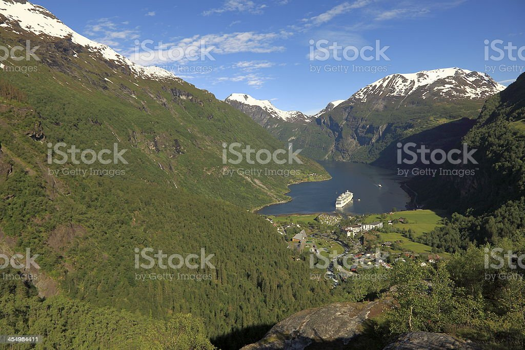 Green Geiranger fjord with cruise ship at sunny day, Norway stock photo