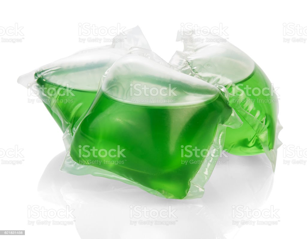 Green gel for washing capsules isolated on white. stock photo