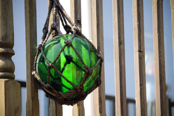 Green Glass Ball Garden Ornament stock photo