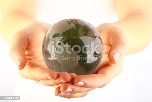 638813890istockphoto Green glass globe in hands 185309019
