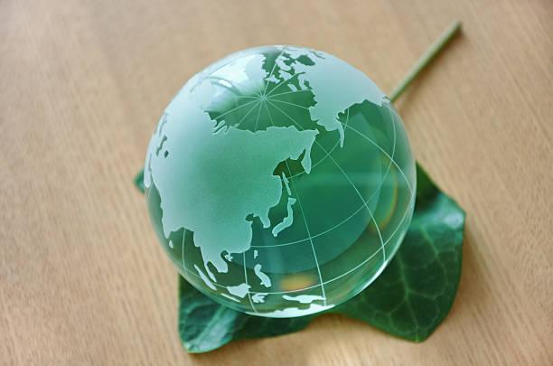 Green glass globe (Eurasian Continent). stock photo