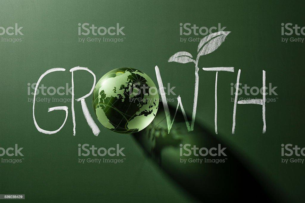 Green glass world globe on blackboard - Chalk Drawing Growth royalty-free stock photo
