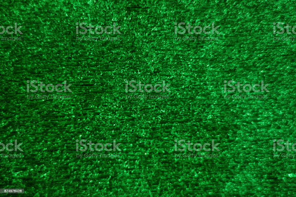 Green glitter abstract festive background with blur bokeh stock photo