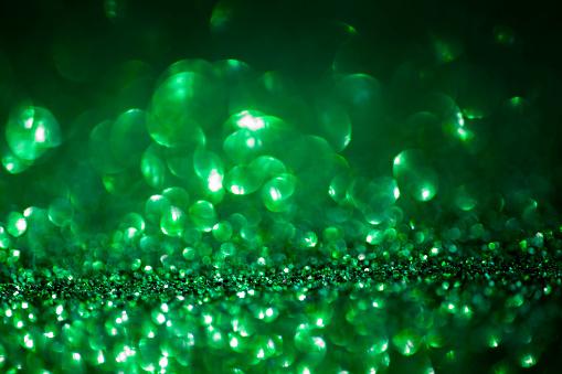 977706014 istock photo Green Glitter Background 1133189231