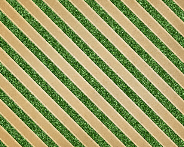 green glitter diagonal stripe paper stock photo