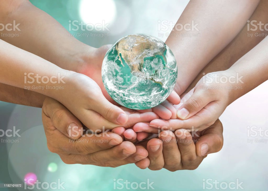 Green globe in family volunteer hands for earth day and CSR with...