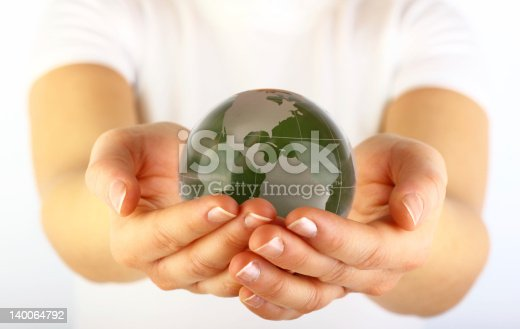 638813890istockphoto Green globe in hands 140064792