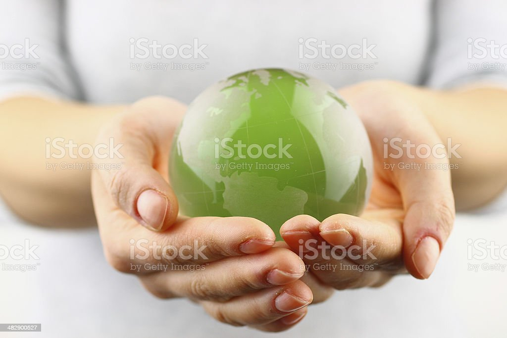Green globe in the hand stock photo