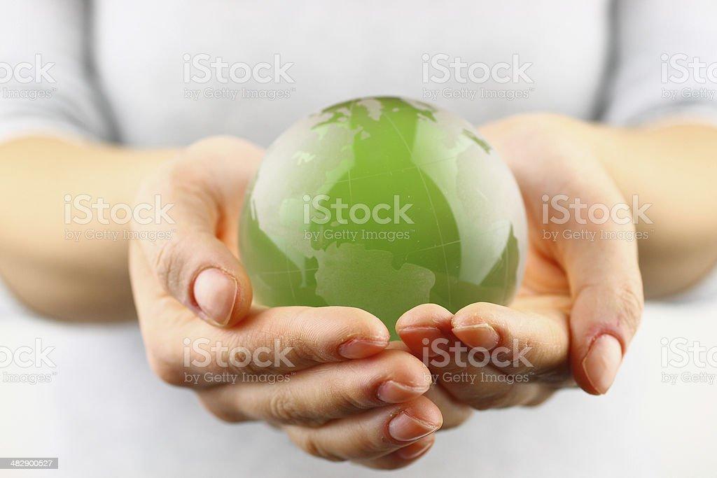 Green globe in the hand stock photo