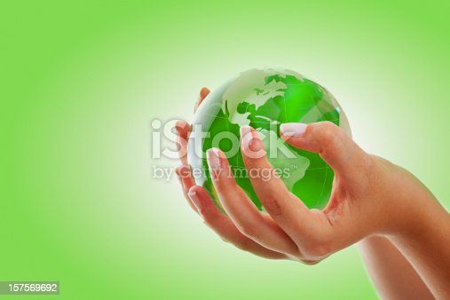 638813890istockphoto Green Globe on the hand 157569692