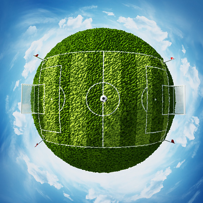 Green globe with soccer field covered with green grass