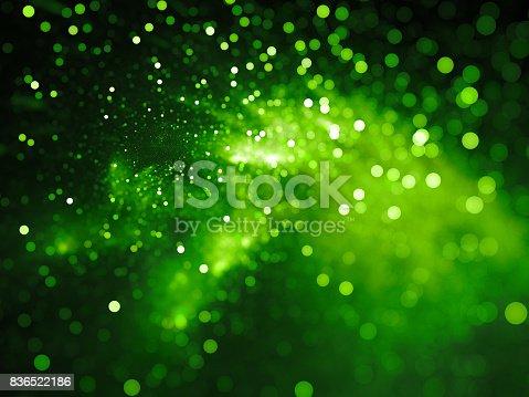 istock Green glowing nebula with stars in bokeh, depth of field 836522186