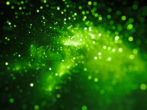 green glowing nebula with stars in bokeh, depth of field - environmental conservation stock photos and pictures