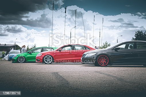 Moscow, Russia - July 6, 2019: Green golf and gray Passat Volkswagen and red Audi A4 - sports cars are parked in the parking lot. A lot of tuned cars.