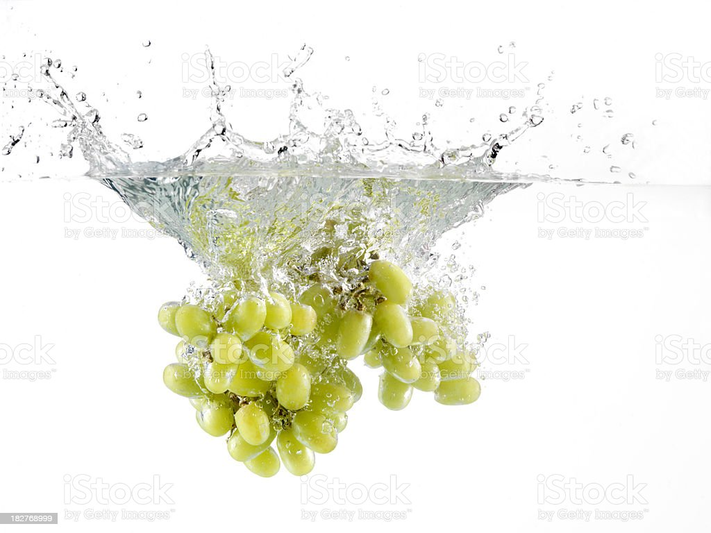 Green Grapes Splashing in Water royalty-free stock photo
