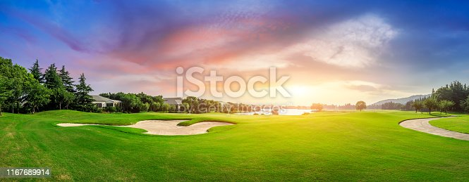 Green grass and woods landscape on a golf field