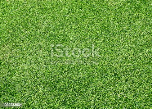 474672896 istock photo Green grass football pitch 1092533604