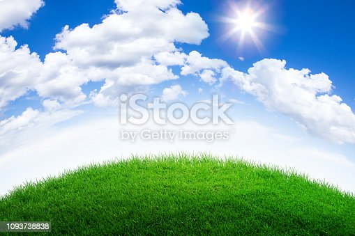 green grass hill and cloudy blue sky