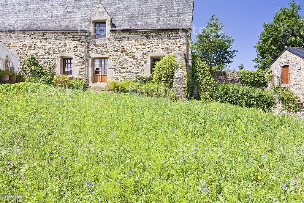 green grass lawn on backyard of old breton estate stock photo