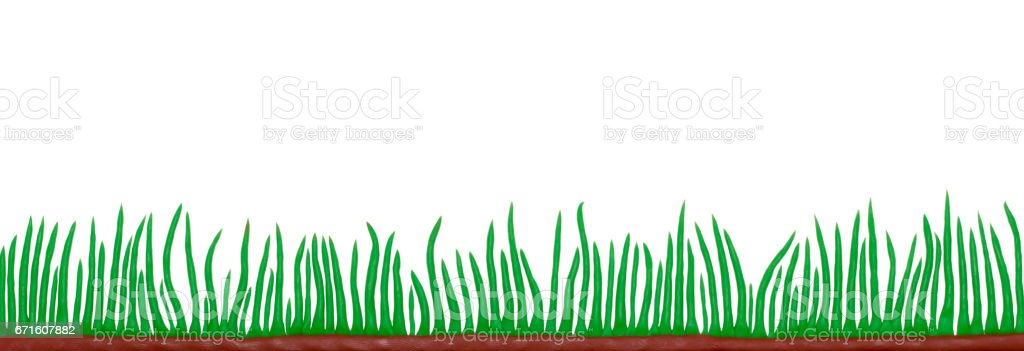 green grass made from plasticine white background stock photo