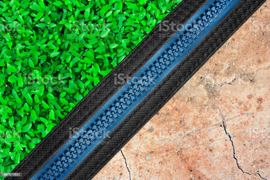 green grass plant with dry soil and zipper, the difference between fertility or abundant and drought for environmental conservation stock photo