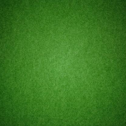Green grunge grass texture with football pitch