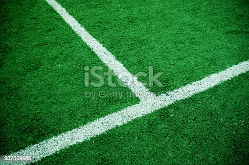 istock Green grass with side boundary textured background 937369656