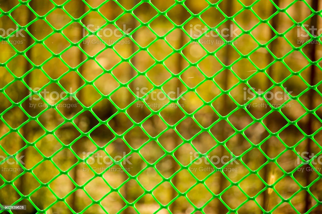 Green grid on the fence as a background stock photo