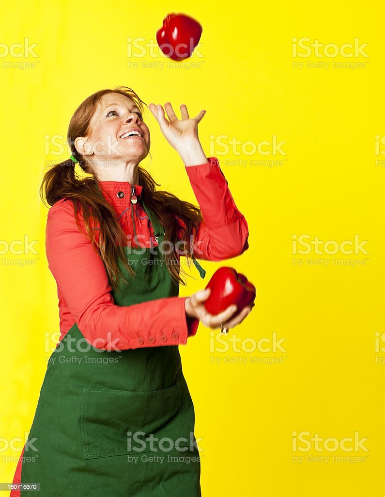 green grocer juggling red peppers royalty-free stock photo