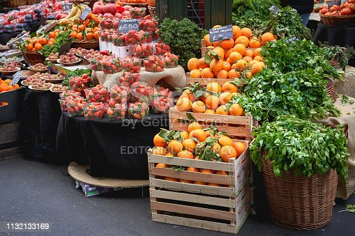 istock Green groceries including oranges, strawberries and parsley on sale at a vegetables stall in Borough Market, the most famous food market in London. 1132133169