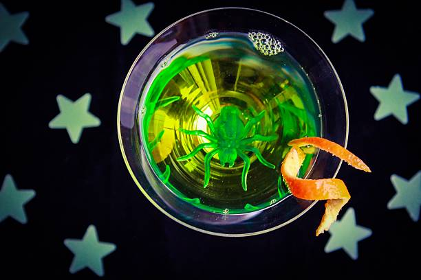 Green Halloween Drink A green halloween drink with stars deathly stock pictures, royalty-free photos & images