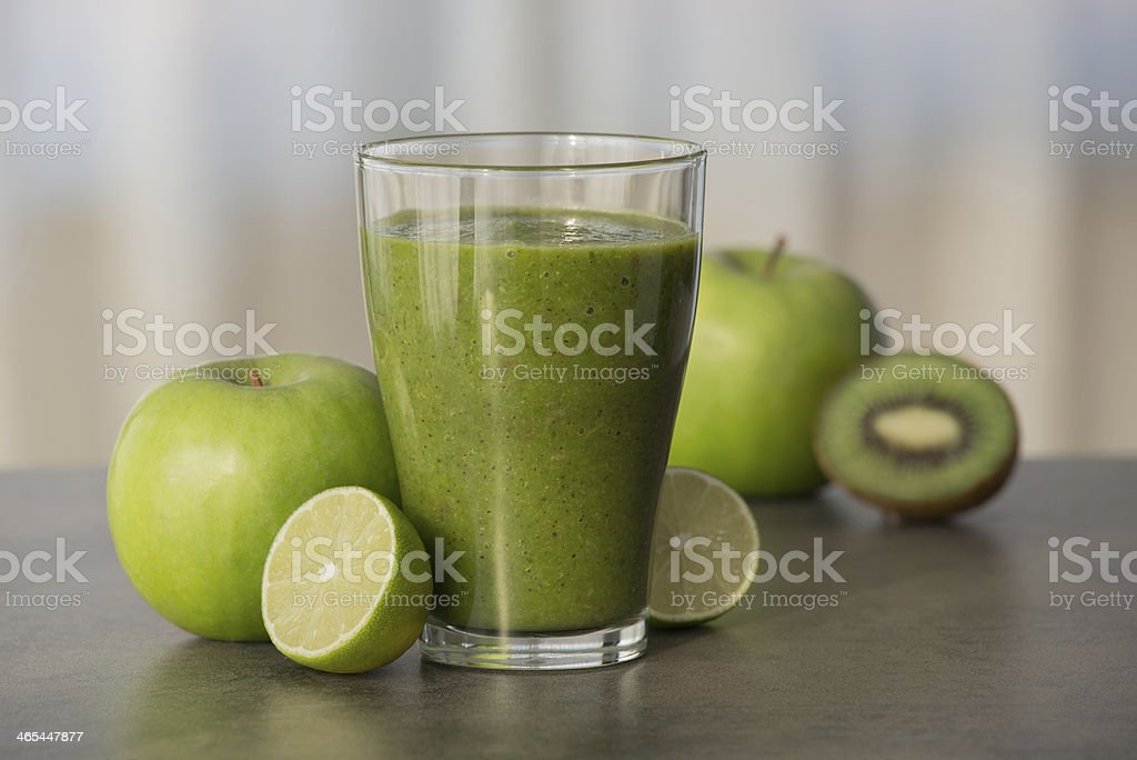 Green healthy smoothie with fruits stock photo