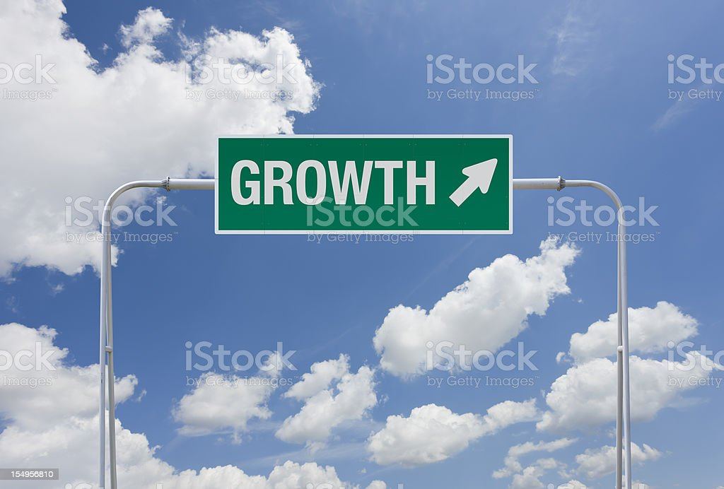 Green highway sign with exit for growth royalty-free stock photo