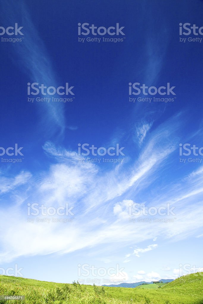Green hill and cloud stock photo