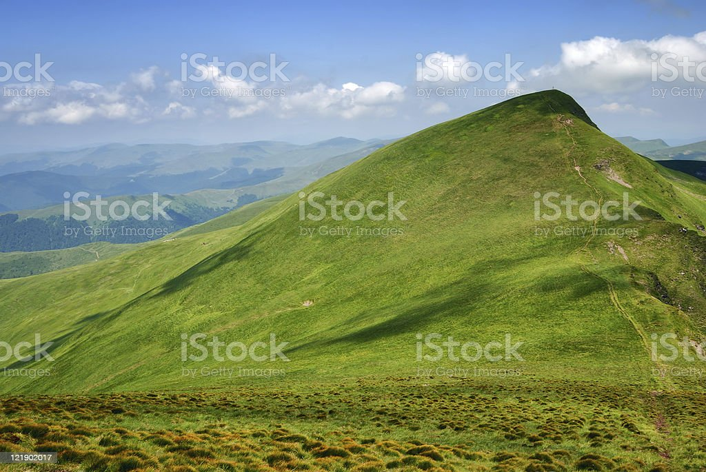 green hill and shadows on mountain valley stock photo
